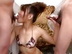 cute japanese cutie strokes cocks and blows very