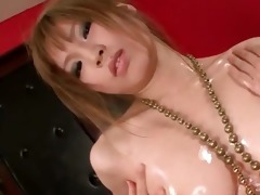 oily oriental temptress opening pink slit in