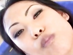 cute oriental floozy drinks cum from a glass cup