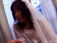 oriental in bride suit shows ass upskirt