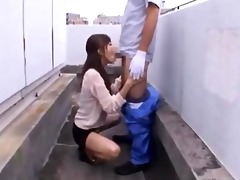 oriental cutie on her knees giving blow job for