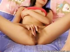 marvelous oriental enjoys playing her hirsute cunt