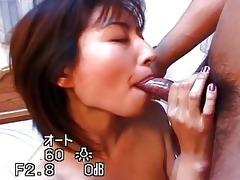 oriental hottie engulfing three-some hard penis