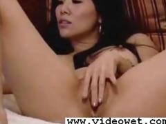 hot oriental slut stuffs her love tunnel on web