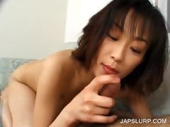 oriental gal engulfing lustful pecker in sofa