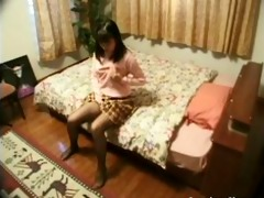 lewd oriental on the daybed rubs her own pantoons