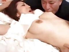oriental gal in white dress getting her mangos