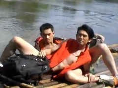 thai lads undressed on a river