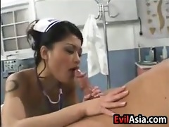 oriental nurse drilled by her patient