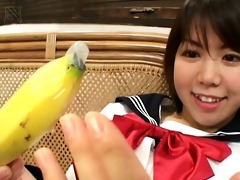 oriental legal age teenager with a banana