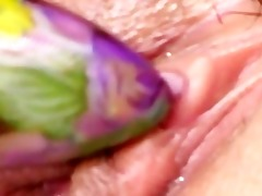 violet sex-toy in a oriental chocolate hole