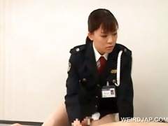 police woman forcing her prisoner to take up with