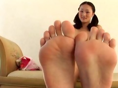 evelyn lin gives a footjob