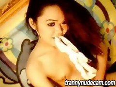 oriental lady-man plays with her weenie