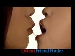 hawt hawt lesbo oriental women giving a kiss