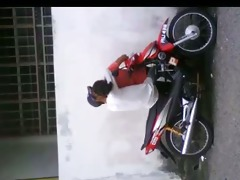 malay pair on bike
