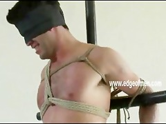 breathtaking stud is fastened up with his hands