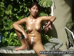 naked oriental girl drills her cunt part3