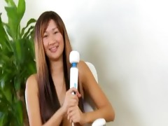 oriental with massive large dildo in act